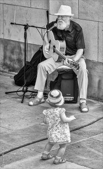 little girl dancing to guitar