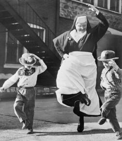 nun and boys dancing